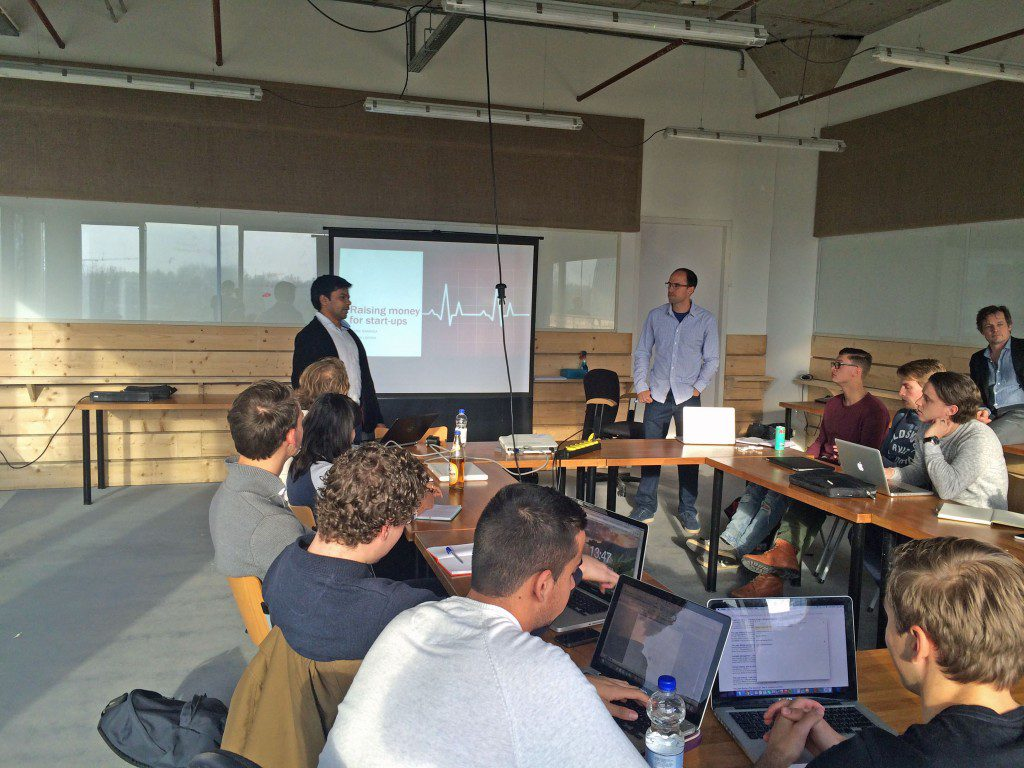 During their onsite visit to Amsterdam, a GFE team had a chance to share their knowledge with a group of young entrepreneurs. This photo shows Rafael Barbosa (MBA '15) and Vaibhav Laddha (MBA '15) presenting.
